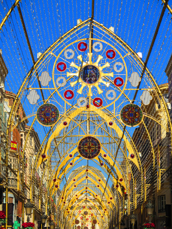 Malaga, Spain - December 22, 2017: Details of Christmas lights in Calle Larios pedestrian street