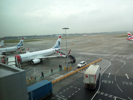 Gatwick, United Kingdom - January 6, 2018: People queing to bord plane on cold and dull foggy morning