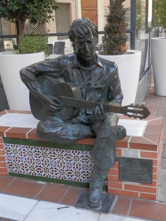 Almeria, Spain - February 8, 2018: Sculpture of John Lennon in town center square