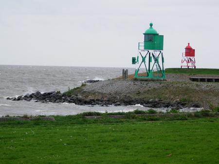 Green grass dike and Choppy waves on Dutch inland sea
