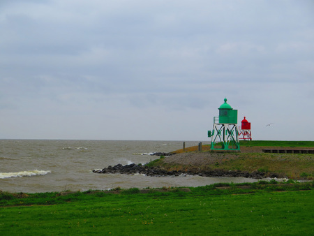 Small lighthouses on polder facing inland sea in Holland 写真素材