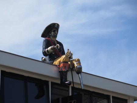Hindeloopen, Netherlands - April 23, 2018: Effigy of Captain Hook on roof in Dutch fishing village