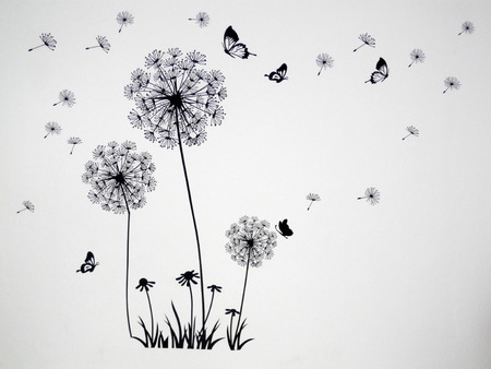 Dandelion seeds and butterflies blowing in the wind