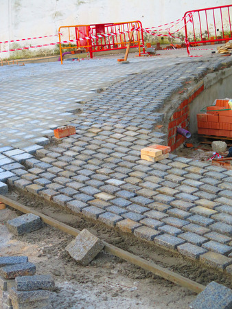 Square paving stones awaiting grouting in village street in Andalusia 版權商用圖片