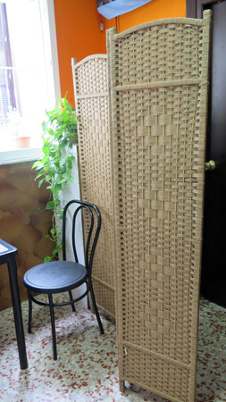 Partition screen in front of toilets at local village bar, Andalusia Stock Photo
