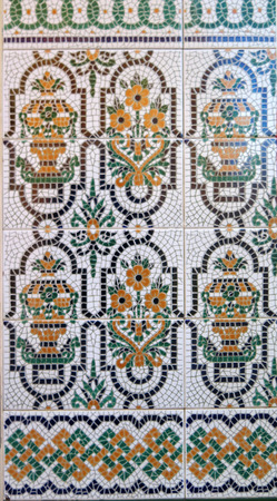 Colorful ceramic tiled wall finish in village in Andalusia Stock fotó