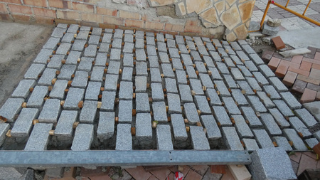 Square paving stones awaiting grouting in village street in Andalusia Imagens