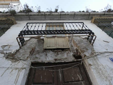 Dangerous unsafe balcony and exit door at village house in Andalusia