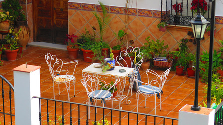 Terrace with table and chairs in Andalusian village