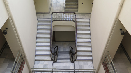 Empty stairwell and steps in old Andalusian building, Malaga