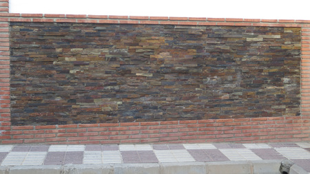 Wall with brick surround and rough granite stone insert in Andalusian village