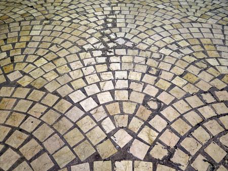 Cobble stone pattern in Malaga pedestrian street, Andalusia