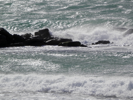 Waves breaking against shore in stormy weather in Tarifa, Andalusia