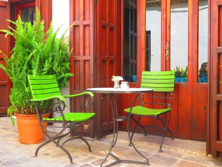Spindly chairs in secluded courtyard in old part of Tarifa, Andalusia