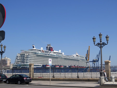 Cadiz, Spain - March 30, 2019: Large cruise liner in harbor on sunny spring day Редакционное