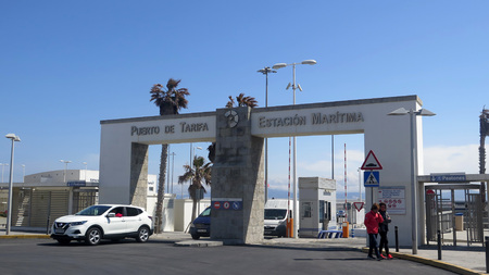 Tarifa, Spain - March 31, 2019: Cars and pedestrians at harbor entrance Editorial