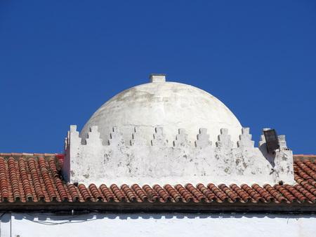 Whitewashed copula on old Tarifa building, Andalusia