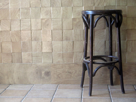 Wooden bar stools in empty restauant in Tarifa, Andalusia Standard-Bild - 123242510