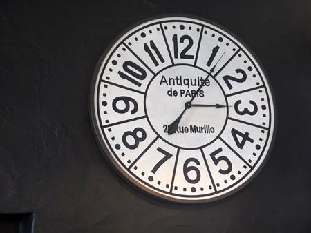 Wooden wall mounted designer clock in bar in Tarifa, Andalusia