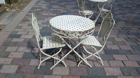 Spindly chairs and table on pedestrian street in old part of Ribe, Denmark Stock fotó