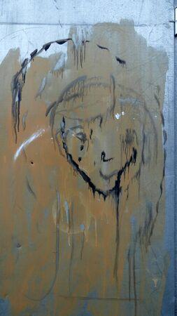 Accidental image in paint splatters on metal door Reklamní fotografie