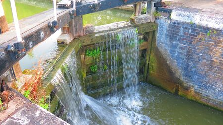 Leaking lock gate on Grand Union canal at Stoke Bruerne, England