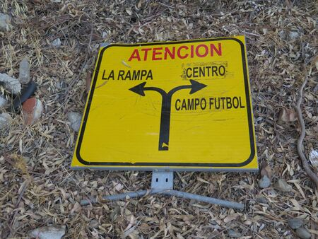 Discarded traffic diversion sign in rural Andalusian countryside