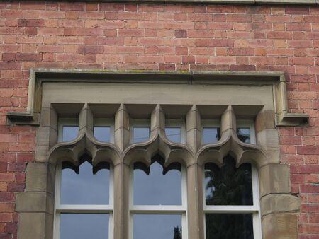 Brick surround decorative window design in English rural village house