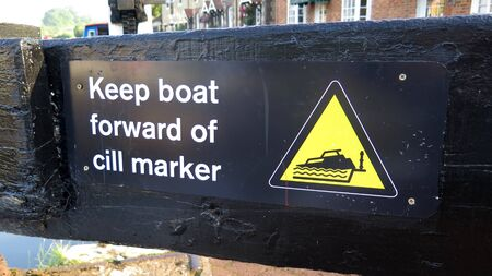 Advice to novice canal boat operators to stay clear of hidden cill in lock