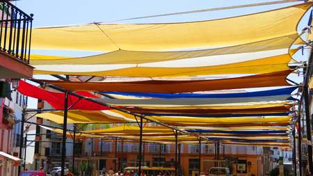 Cloth covered main square in Andalusian village ready for annual aeek long festival
