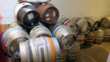 Reading, United Kingdom - August 9, 2019: Real ale beer barrels stacked in corridor at old English pub in Reading, Berkshire 에디토리얼