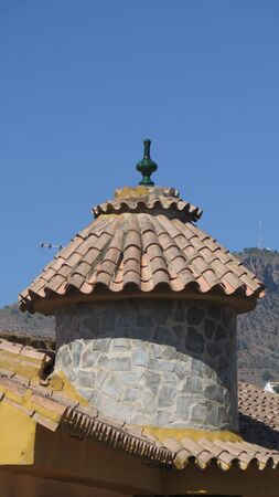 Turret on village restaurant in rural Andalusia against clear blue autumn sky Stok Fotoğraf