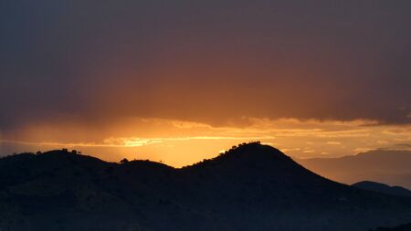 Beautiful golden summer sunrise over hilly Andalusian countryside 版權商用圖片