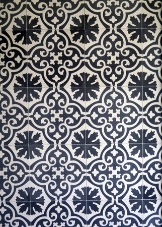 Closeup of dark blue and white ceramic tiles on wall in village in Andalusia