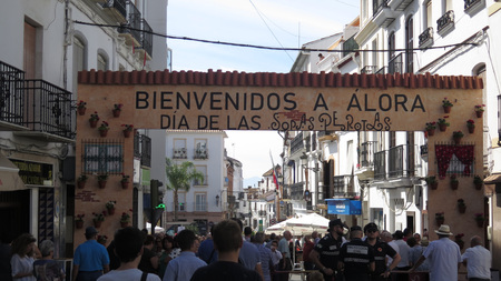 Alora, Spain - October 5, 2019: People gathering below Annual soupday portal in Andalusian village