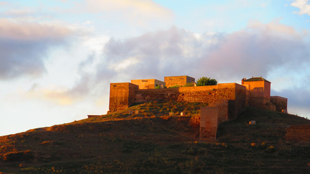 Alora, Spain - November 1, 2019: Back view of Arabic castle in Alora village, Andalusia