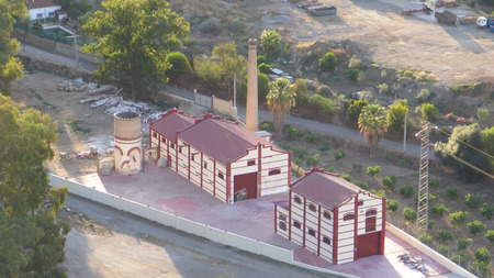 Tall brick built chimney at disused Alora perfume factory undergoing renovation, Andalusia 新聞圖片