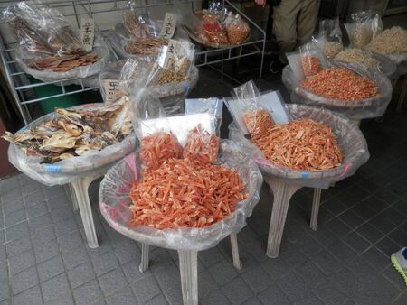 Display of Dried fish on plastic bags in Hong kong fishing village