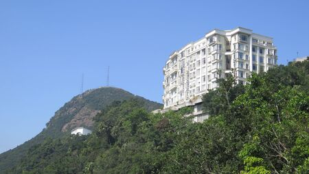 View of tall Hong Kong Skyscraper against blue November sky