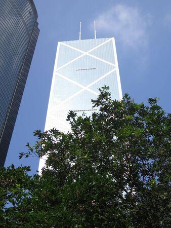 Tall Hong Kong Skyscraper against blue November sky
