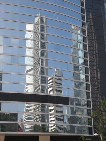 Tall skyscrapers reflection in business district on Hong Kong Island Stockfoto