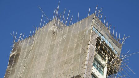 Intricate bamboo scaffolding on building in Hong Kong business district