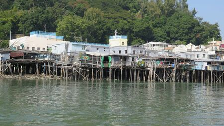 Tai O is home to the Tanka people, a community of fisher folk who've built their houses on stilts above the tidal flats of Lantau Island for generations Stockfoto