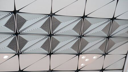 Closeup of decorative ceiling tiles at Hong Kong International airport Stockfoto