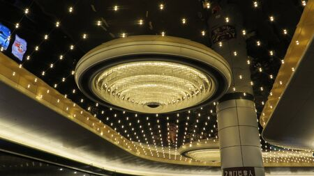 Macao, East Asia - November 21, 2019: Inside view of Macao Casino building withlarge elaborate ceiling lights