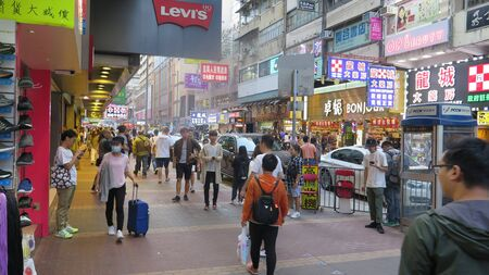 Hong Kong, East Asia - November 24, 2019: Mongkok in Kowloon is one of the most neon-lighted place in the world and is full of ads of different companie Redactioneel