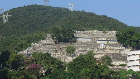 Terraced tombs at Chinese Permanent Cemetery seen from Aberdeen harbor, Hong Kong Island