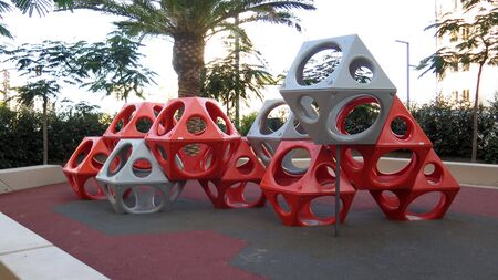Plastic cubes with holes at children playground in Malaga, Spain Stockfoto