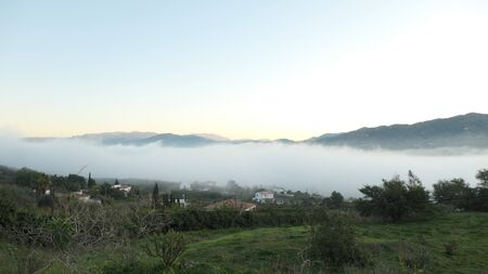Early morning fog in valley with clear blue sky and green fields Фото со стока - 139908552