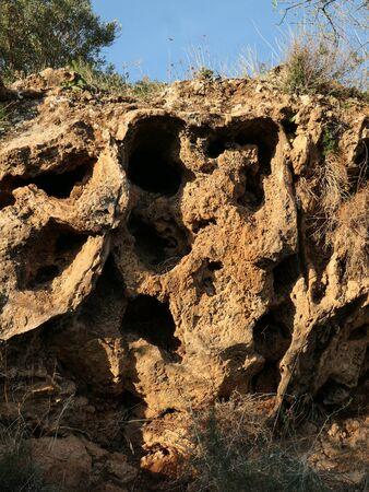 Weathered rock in rural Andalusia, Spain resembling human cranium skull Archivio Fotografico